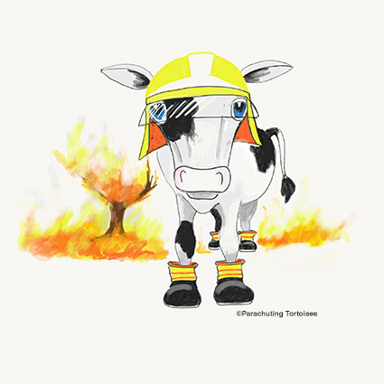Cartoon cow putting out a fire
